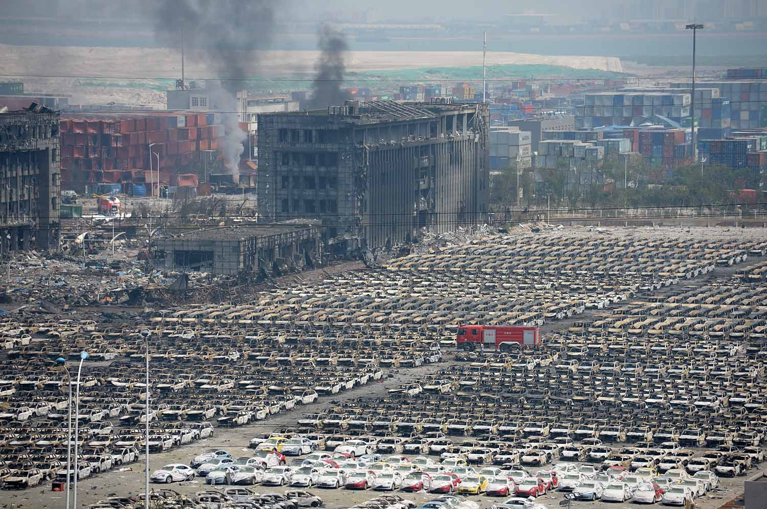 TIANJIN, CHINA - AUGUST 13:  (CHINA OUT) Thousands of burnt and destroyed vehicles are seen in Tianjin's warehouse explosion on August 13, 2015 in Tianjin, China. The death toll from Wednesday warehouse explosions in Tianjin rose to 50 Thursday evening, 17 of whom were firemen, local authorities said.  (Photo by ChinaFotoPress/ChinaFotoPress via Getty Images)