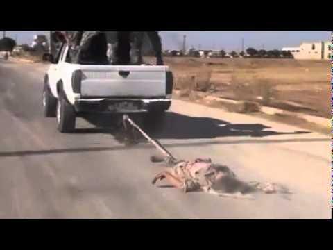 ODMAZDA: Vezanog ISIL-ovca zavezali za automobil i vukli ulicama grada