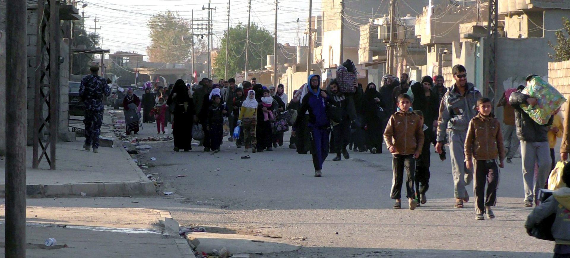 HAMMAM AL-ALIL Pronađena masovna grobnica sa više od 100 obezglavljenih tijela