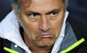 Real Madrid's coach Jose Mourinho, from Portugal, reacts during a quarterfinal, second leg, Copa del Rey soccer match against FC Barcelona at the Camp Nou stadium, in Barcelona, Spain, Wednesday, Jan. 25, 2012. (AP Photo/Manu Fernandez)