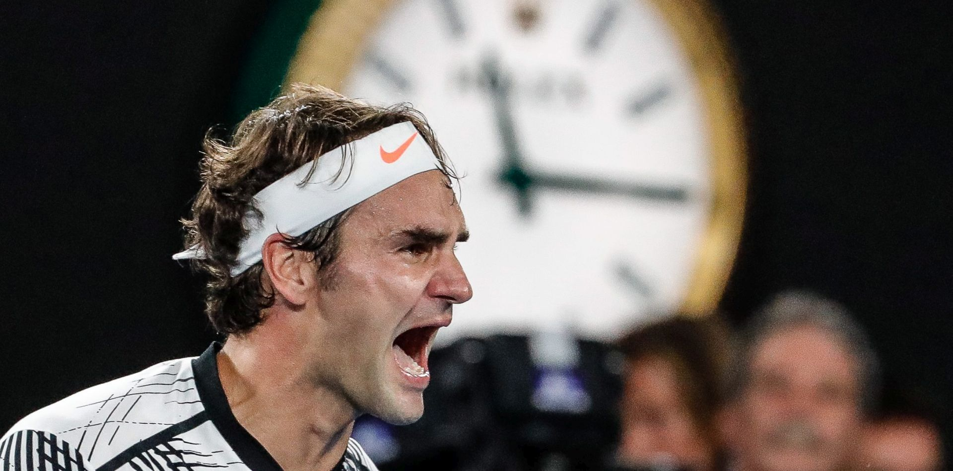 epa05758920 Roger Federer of Switzerland celebrates winning against Rafael Nadal of Spain during their Men's Singles final match at the Australian Open Grand Slam tennis tournament in Melbourne, Victoria, Australia, 29 January 2017. EPA/MADE NAGI
