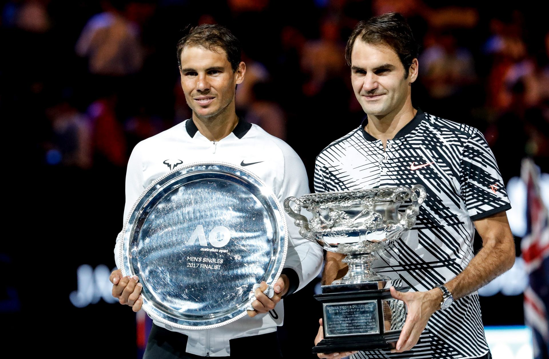 epa05759114 Roger Federer (R) of Switzerland celebrates with the trophy after winning the Men's Singles final match against Rafael Nadal (L) of Spain at the Australian Open Grand Slam tennis tournament in Melbourne, Victoria, Australia, 29 January 2017.  EPA/MADE NAGI