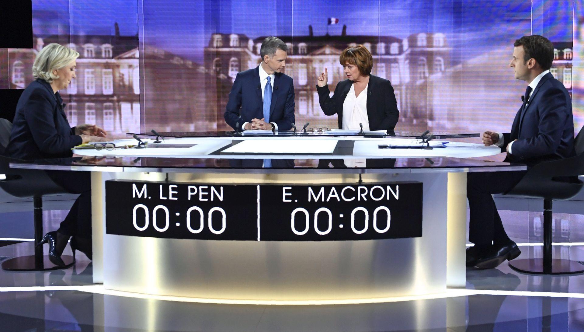 Le Pen i Macron razmijenili oštre udarce u debati