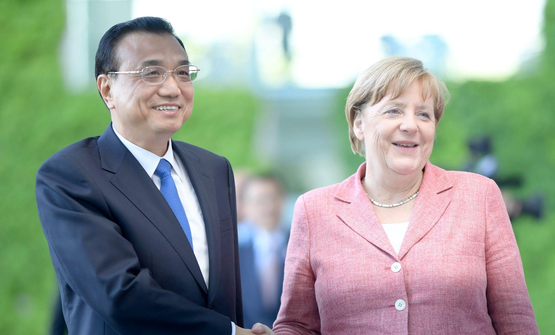 Merkel i Li za klimatski sporazum i slobodnu trgovinu, protiv Trumpa