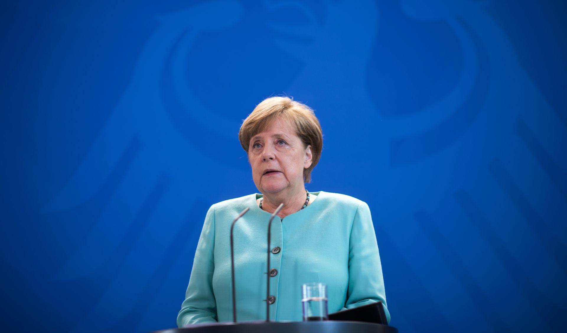 Merkel uoči summita G20 kritizirala Trumpa