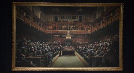 Banksyjeva slika parlamenta majmuna na dražbi prodana za preko 11 milijuna eura