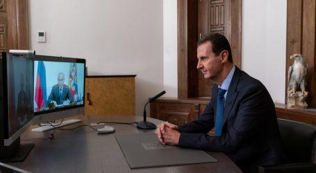 Putin i Asad pozivaju izbjeglice da se vrate i izgrade razorenu Siriju