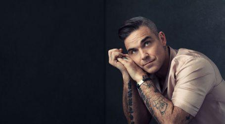 "Robbie Williams ismijao Borisa Johnsona u novom spotu ""Can't Stop Christmas"""