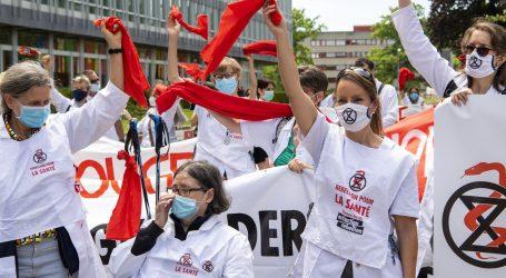 Liječnici pred zgradom WHO-a u kampanji za očuvanje okoliša i zdravlja