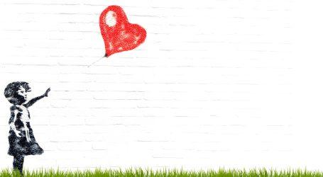 """Ljubav je u kanti"": Izrezani Banksy prodan za više od 21 milijun eura"